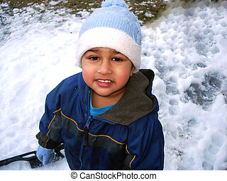 Enjoying snow - An Indian kid enjoying the snow after a...