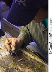 Indian jeweler - Indian master jeweler making a silver ear...