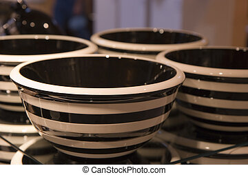 Black and White Bowls - Stacks of ceramic black and white...