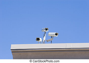 Rooftop Security - A cluster of security cameras on a...