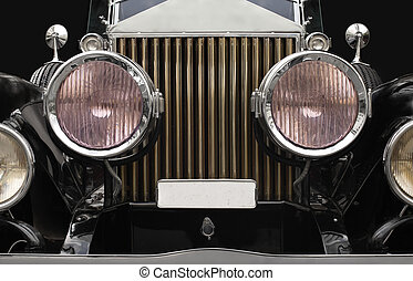 Antique car headlamps - The grill and headlamps of an...