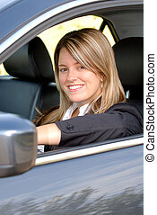 Woman Driving Her Car - Happy Smiling Blond Businesswoman...