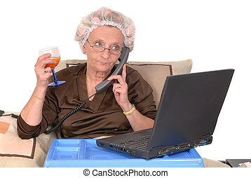 Working at home - Middle aged businesswoman in bed, laptop...