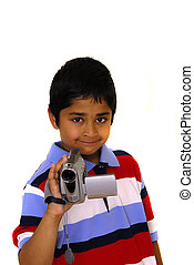 Video Camera - An handsome Indian kid holding a video camera