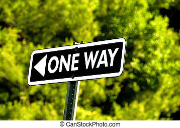 One Way - One way road sign againt a green back ground