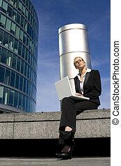 Hi Tech World - A beautiful young female executive using her...