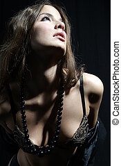 erotic woman - an erotic woman with bra and pearl necklet