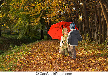 Mother and son in the autumn park