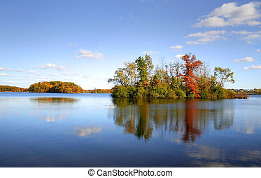 Autumn Tree Reflections - Reflections of colorful trees in...