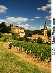 Beaujolais girl - Image shows a blond country girl walking...