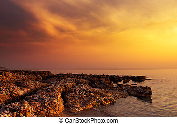 Sunset rocks - Image shows a rock formation under a...
