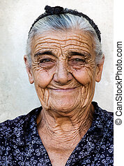 Happy old lady - Image shows a happy old lady from a village...