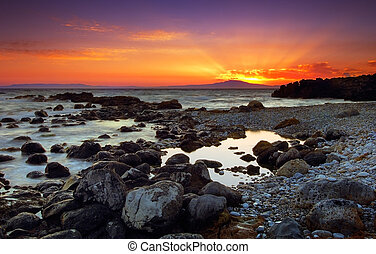 Glorious sunset over rocky seascape