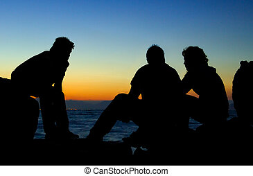 Three friends - Image shows silhouettes of 3 young people...