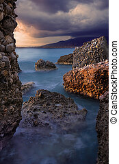 Rocky seascape - Image shows a rocky seascape during a windy...