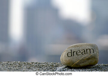 solid dreams - dream rock sits on cement ledge with the...