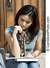 College student - A beautiful college student studying at...