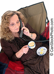 Woman, coffee break phoning - Middle aged businesswoman in...
