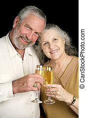 Champagne Toast Vertical - Good looking mature couple...