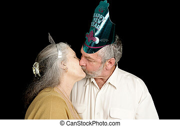 New Years Kiss - Happy mature couple exchanging a passionate...
