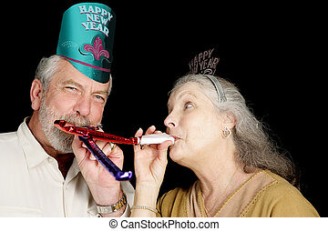 New Years Party Fun - Mature couple in New Years party hats...