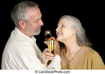 Romatic Champagne Toast - Good looking mature couple...