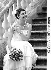 Bride smiling on her wedding day - Black and White photo of...