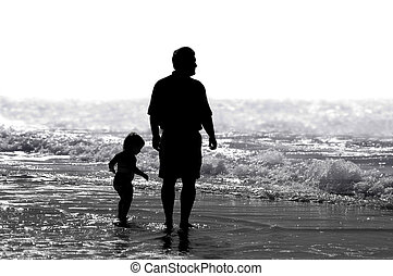 Father & Child - A father and child strolling on the beach.