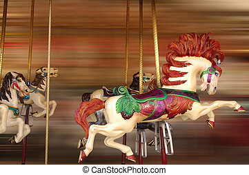 Horse Ride - Horse rides at a merry-go-round with background...
