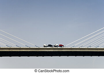 Cars over the bridge - Truck with cars crossing a bridge