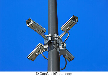 Security Cameras - Close-up of four security cameras on pole...