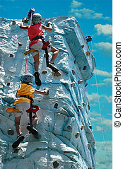 The Goal - A team (two kids) climbing the top of a rock wall