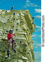 To The Top - A young boy climbing to his goal on a rock wall