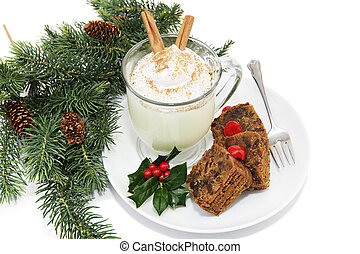 Eggnog and Fruitcake - Holiday fruitcake and eggnog on a...