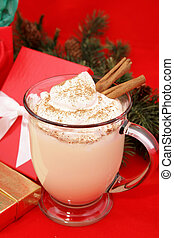 Festive Christmas Eggnog - Christmas eggnog in a mug with...