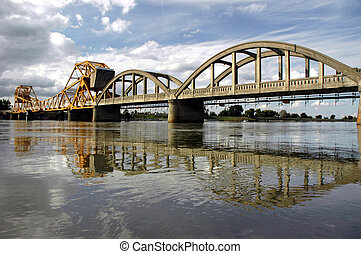 Drawbridge Reflection Over Sacramento River Under Springtime...