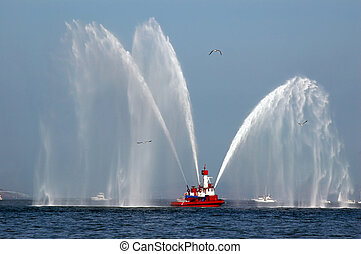 Fireboat in Action - Red Fireboat Spraying Streams of Water
