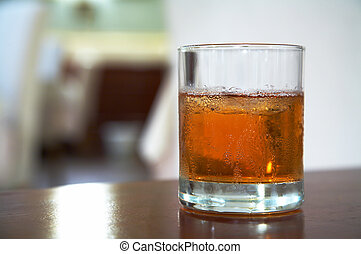 glass of whisky - The misted over glass of whisky with an...