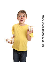 Child showcasing gifts - Child holding several gifts in one...
