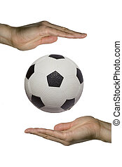 Holding the Soccer ball - two hands holding a soccer ball...