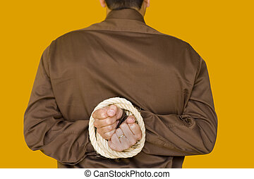 arrested businessman - a bussiness man with his hands tiedup...