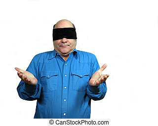 Blindfolded with arms out - A man in a blue shirt...