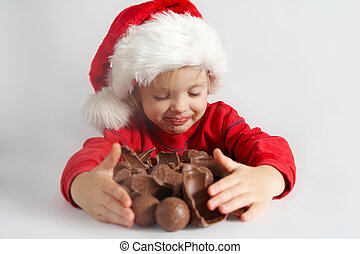 Little chocolate Santa - Little girl wearing red Santa hat...