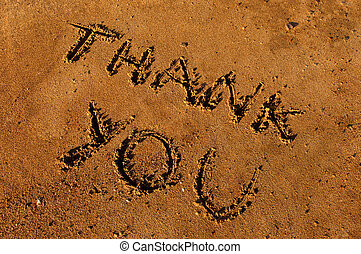 Thank you - Image shows a Thank youmessage writen on wet...
