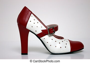 High Heel - A side view of a ladies red and white high heel...