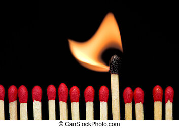 Burning match - A row of matches, with one of them burning.