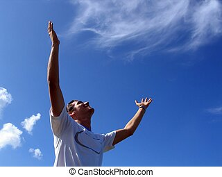 Success - Young man with open arms towards the sky
