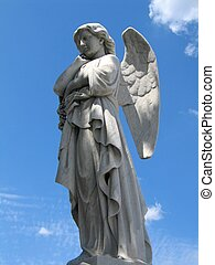 winged angel statue - Detail of winged angel statue against...