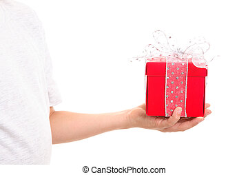 Christmas Gift - Hand holding a red box tied up with sparkly...
