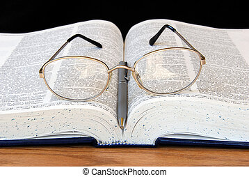 Study Time - Open Dictionary with Pen and Glasses